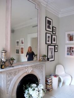 Gallery by the fireplace, via Anna Spiro