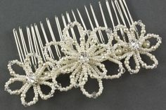 Felice Pearl Floral Wedding Hair Comb. The Felice Comb is a beautiful floral hair accessory, featuring a large beaded double flower nestled between two smaller beaded flowers. Each flower is embellished with a pretty crystal centre and tiny pearls and crystals. Available in a fabulous range of seed bead, pearl and crystal colours.