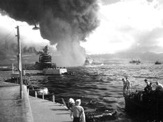 Battleship Row The USS California, left, takes on water after receiving two torpedo hits. In the center are USS Maryland with the capsized USS Oklahoma alongside. USS Neosho is at right, backing clear of the area. Most smoke is from USS Arizona.