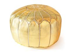 Give your Living room some gilded glamour with this gold pouf. This fancy Moroccan gold pouf handmade and covered with shiny gold leather. Sand-toned embroidery gives this pouf its honeycomb pattern and round shape.