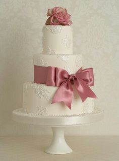 This is so pretty-love the simple elegance! Would suggest merlot ribbon and ivory rose