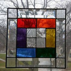This stained glass panel was made using the 6 colors of the rainbow (red, orange, yellow, green, blue and violet) in stained glass as well as clear textured glass, finished off with 4 leaded glass crystal bevels. Each piece was hand cut, all edges were then ground smooth, followed by foiling all the edges of each piece, then soldering them all together. this stained glass window panel was then framed in a zinc channel frame. measures 9 wide by 9 long loops and line attached, ready to hang…