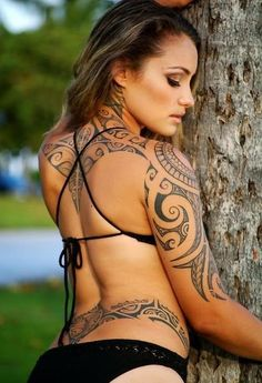 Tribal tattoos for women.... I mainly see these on men, but now I know I really like them on women too!