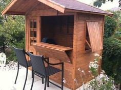 driveway - outdoor kitchen shed with fold down table and flip up shade