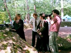 Alfonso Cuarón with the cast and crew while filming Harry Potter and the Prisoner of Azkaban (2004)