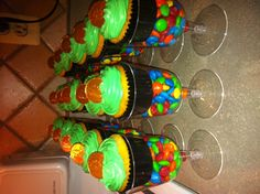 St. Patrick's Day Treats- Plastic Wine glasses from the dollar store. Black cupcake liner (pot of gold look), gold coin to top it all off!