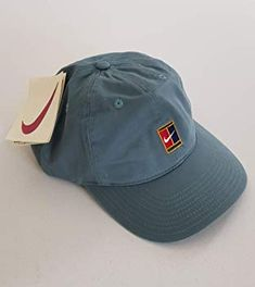 17c3f470f91 Vintage Nike Supreme Court Pete Sampras   Andre Agassi Tennis Clothing · Nike  Supreme Court Tennis Cap  Amazon.co.uk  Clothing