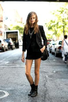 model off duty street style - new york - all black ensemble, mini dress + fitted blazer with black biker boots and wavy hair