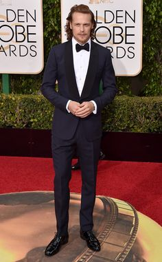 Sam Heughan from Best Dressed Men at the 2016 Golden Globes Holy hotness! The Outlander star and his lock tresses look great in this deep blue suit.