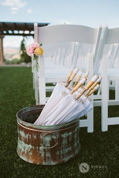 Parasols for guests at our sunny summer wedding
