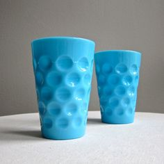 Two Blue Milk Glass Tumblers Thumbprint Pattern Drinking Glass 1950s. via Etsy.