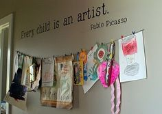 Cute way to display your child's art, (minus the wall decal). Laundry Room wall, perhaps? Would look cute and appropriate with clothespin attaches. And you'd see it everyday.