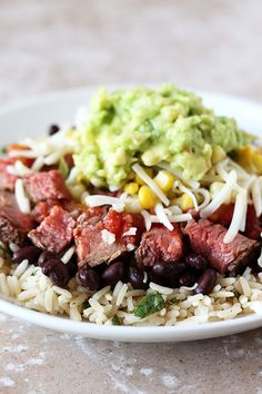 Steak Burrito Bowls - Handle the Heat. Be sure to use fat-free cheese and sour cream for Simply Filling.