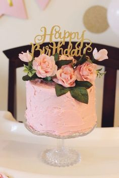 This pink first birthday cake is just gorgeous! The fresh roses on top are showstoppers....
