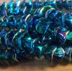 Czech glass 12mm three petal metallic blue peacock beads. www.gypsybeadpeddler.etsy.com