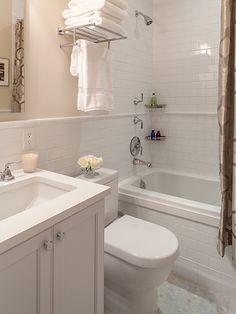 Good example of white subway tiles with preferred grey for Small full bath designs