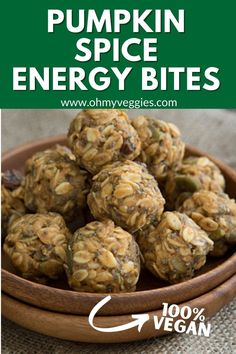 This Vegan Pumpkin Spice Energy Bites recipe is made with pumpkin puree, almond butter, oats, pepitas, raisins, and chia seeds, and maple syrup. #energysnack #snacks #desserts #vegetarian #lowcalorie #vegan