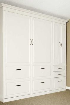 Photo of a closed murphy bed with a wardrobe style side cabinet