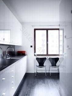 narrow white kitchen