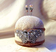 Petite Papillon lace pin cushion with tack pins.  GaffneyGirlStudio @ Etsy.