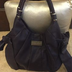 Bisou Bisou Large Deep Purple Purse Leather-Like material. Bag and inside are in great shape. Bag has a large zip pocket on inside and back(outside). There is a dividing zipper pocket in the middle and 2 slide in pockets. Great bag with no cracks or scrapes! Bisou Bisou Bags Satchels