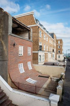 The Sliding Facade Abandoned Building in Kent, UK is an art installation by artist Alex Chinneck.  It will only stand for a year so if you're in town, stop by to check it out.