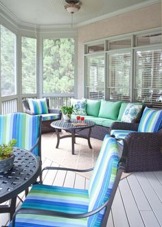 This screened-in porch maximizes outdoor living potential by using every nook for seating. Screens protects guests from bugs while a ceiling fan keeps them cool and comfortable when temperatures start to climb.