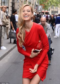 Turning heads: Looking stylish as usual, the 36-year-old model dressed her lean and slende...