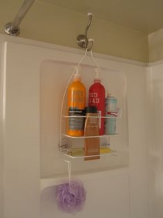 Hang a shower caddy on the opposite side of the shower with a coat hook so it doesnt interfere with the faucet- And stuff doesnt get all mildewy and gross