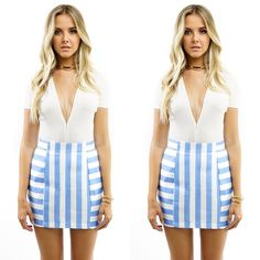 BABY BLUE STRIPED MINI SKIRT Feel fun and flirty with this Baby Blue Striped Mini Skirt featuring horizontal and vertical baby blue stripes - front & back, mini-length, and a back zipper closure. Mixed with a soft white and a shoulder purse and you're ready for some adventures in the city. Pictures are showing a small. 100% Polyester   Baby-blue/White   Two-Tone Strip pattern Mini-skirt Back zipper closure Style Link Miami Skirts Mini
