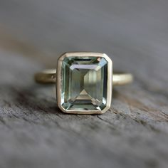 Emerald Cut Green Amethyst Ring, Prasiolite Ring in Recycled 14k Yellow Gold, Made in Your Size. $898.00, via Etsy.