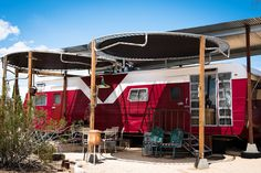 1958 Vintage Red Rocket 7 x 38 foot Trailer with over-storied corrugated shade   structure and re-purposed trampoline patio shade awnings. Very cool stack awning windows very originally restoration.