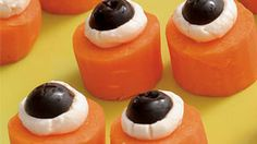 Halloween treats for the family: Edible Eyeballs - slice carrots into 1-inch-thick chunks, top each with a blob of cream cheese, and one half of a pitted black olive