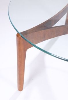 "Mid-century Modern circular coffee table  A Mid-century Modern glass table top with rosewood base 17 3/4""h x 40"" diam."