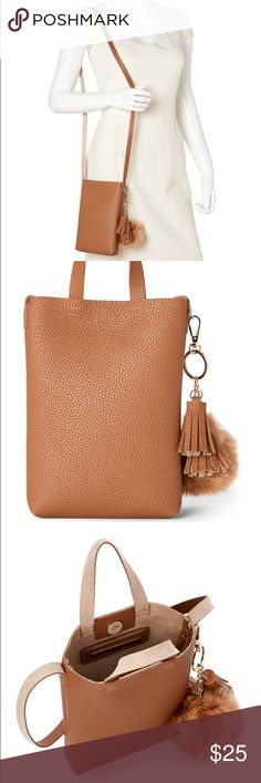 "Street Level Tan Shoulder Bag w Faux Fur Pom-Pom BNWT, never used. It comes with the dust bag. The size and shape of the bag is so unique and is a necessary addition to any bag/purse/handbag collection!   Pebbled faux fur exterior, handles, snap closure Strap, detachable faux fur and tassel key ring, unlined 5 1/2"" L x 8"" H x 1 1/4"" W  Brand: STREET LEVEL Street Level Bags Shoulder Bags"