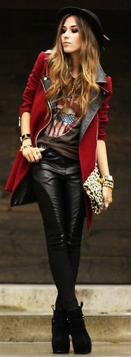 Leather detail riding pants compliment the garnet red long jacket. sparkle clutch is a nice surprise. great black hat. Steep platforms.