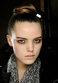 Flat buns at Louis Vuitton    At Louis Vuitton, hair was placed on top of the head and twisted into a tight, flat bun.
