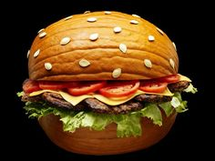 Pumpkin carved and decorated like a cheeseburger by Food Network chef Claire Robinson!