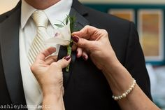 The groom's white tie looks so classic with this white orchid boutonniere | Fall Wedding Reception at Maggiano's Little Italy Oak Brook, IL | Ashley Hamm Photography