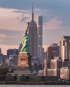 Midtown Manhattan and the Statue of Liberty by nyclens - The Best Photos and Videos of New York City including the Statue of Liberty, Brooklyn Bridge, Central Park, Empire State Building, Chrysler Building and other popular New York places and attractions.