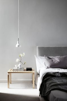 Great minimalist bedrooms! Stunning grey and white colour schemes. #Neutral colours matched with simple textures and timbers. Love the simplicity and minimalist styles.
