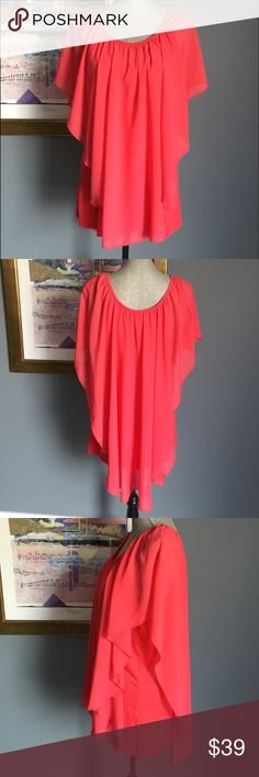 Cha Cha Vente Top Sweet coral colored top from Cha Cha Vente .  Features a solid stretchy top underneath of a flowing chiffon overlay .  Very flattering .  Outer layer made of 100% polyester .  Underneath made of 95% rayon/5% spandex .  Machine wash/dry .  NWOT Cha Cha Vente Tops Blouses
