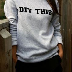 Create a chic and on-trend word phrase sweatshirt with just a couple of supplies. DIY THIS!