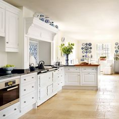 I like white kitchens, but not super modern and sleek where everything has to be just so. I want a kitchen to live in and enjoy, not break my heart over keeping it immaculate. A kitchen should look better when loved and lived in.