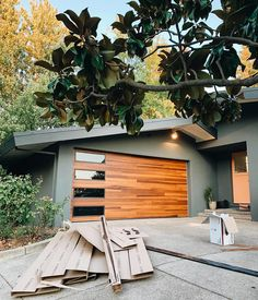 Horizontal grooves lend texture and interest to Planks doors, creating depth and subtle dimension. Exterior House Colors, Exterior Design, Garage Door Colors, Garage Door Design, Modern Garage Doors, Midcentury Modern Front Door, Modern Interior Doors, Modern Home Exteriors, Modern Exterior House Designs