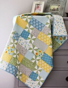Simple quilt pattern with pinwheels, straight line quilted on the diagonal