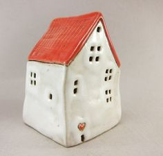 Hand formed whimsical ceramic house from buff stoneware.    Textured roof, stamped windows, etched heart. One of a kind.    It´s big: 45x62x39mm or