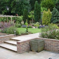 Is your garden a bit, umm. Sloping gardens are challenging for home owners & designers alike. Here are a few ideas for coping with a sloping garden. Outdoor Paving, Garden Paving, Terrace Garden, Patio Garden Ideas Uk, Easy Garden, Garden Spaces, Small Patio Design, Back Garden Design, Garden Design Plans