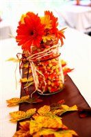 Fall Decor.  Silk Flowers and Candy Corns in a jar/vase with Raffia