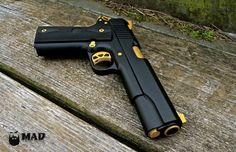 Ruger 1911 in MAD Black with Gold accents - Mad Custom Coating Custom 1911, Custom Guns, Weapons Guns, Guns And Ammo, Ruger 1911, Winchester, 1911 Pistol, 1911 Grips, Cool Guns